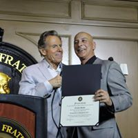 Frankie Sands Inducted into the Friars Club being presented with his Certificate by Bill Boggs.
